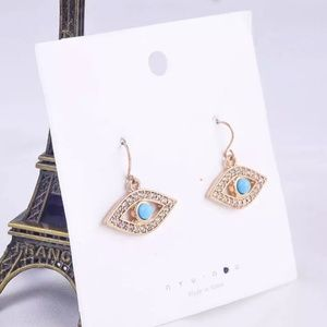 NEW Gold All seeing eye jeweled dangle earrings